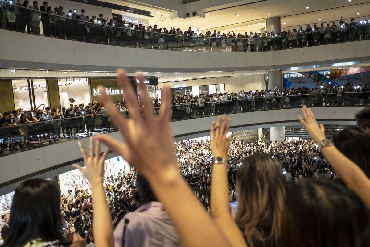 Hong Kong Unrest Rocks Insurers' Sales as China Buyers Balk
