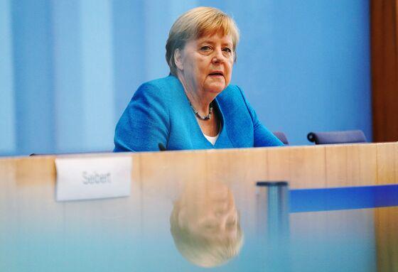 Merkel Warns of Long Road Ahead in Europe's Virus Crisis