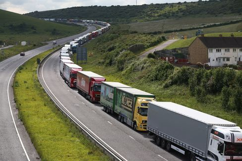 Trucks queue up as part of Operation Stack in Dover, England. Ferry workers blockaded the port of Calais in France to protest job cuts.