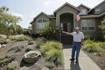 Homeowner Bill Crowell shows off his garden, designed to use less water, at his home in Santa Rosa, California.