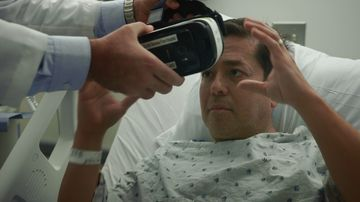 A patient at Cedars-Sinai Medical Center tries out a VR headset for the first time