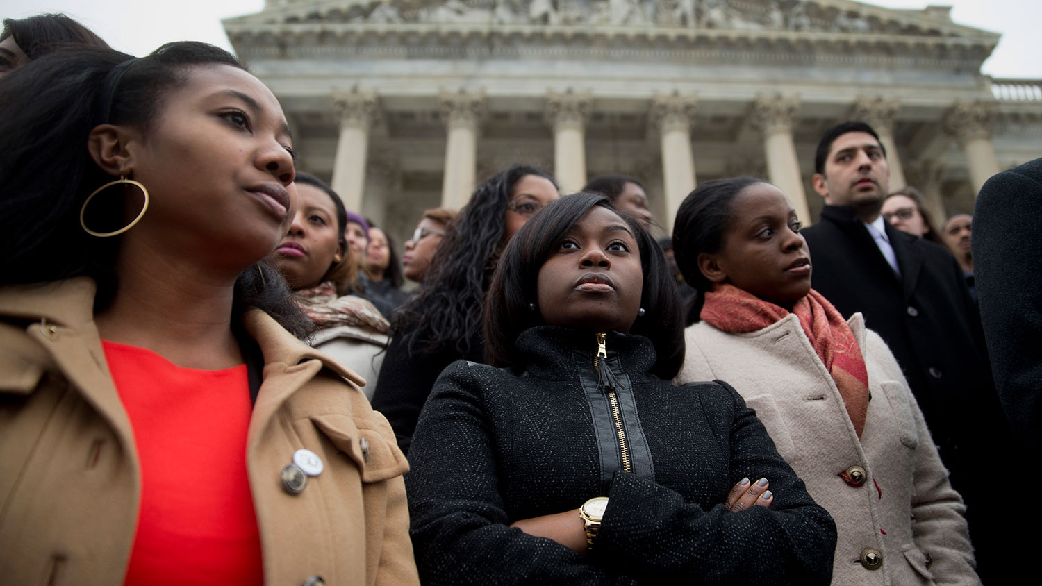 Congressional staff members stand on the U.S. Capitol steps during a protest in Washington on Dec. 11, 2014.