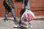 A shopper carries Target Corp. shopping bags while walking in New York.