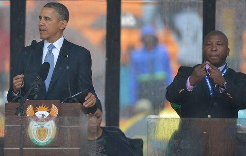 President Obama Speaks next to Interpreter Thamsanqa Jantjie