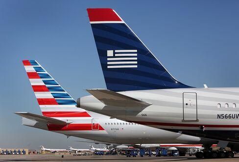 AMR Nearing US Airways Merger Focuses Overseas With Longer Trips
