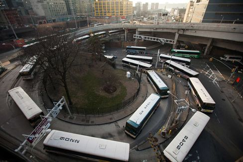 Buses wait in line to enter the Port Authority Bus Terminal in New York.