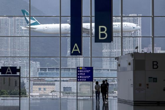 Cathay Pacific's Dire Run Eases as First-Half Losses Narrow