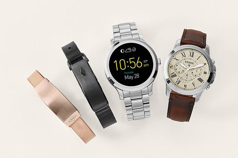 A selection of Fossil first-generation wearables, including fitness bands and smartwatches.