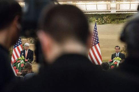 John Kerry, left, and Wang Yi speak in Beijing.