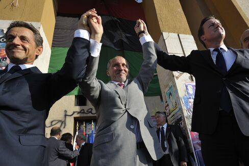 Libyan Rebels Fight for Sirte as U.K., France Pledge Aid