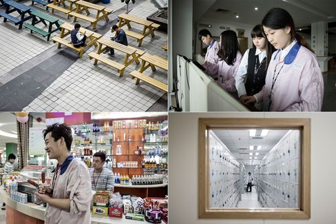 Clockwise from top left: Workers relax on benches during lunchtime; employees check their pay stubs at a computer terminal; a worker changes into his uniform; an employee in the canteen.
