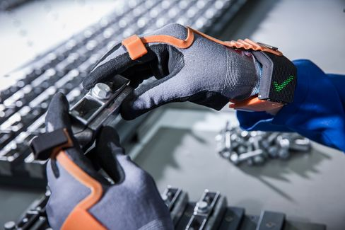 """ProGlove,developed by Workaround,is an """"intelligent"""" glove that uses chips to power a simple display on the wrist. If the person wearing the glove completes an assembly task correctly,a large green check mark appears."""