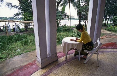 Aung San Suu Kyi under house arrest at her lakeside Yangon mansion in 1996.