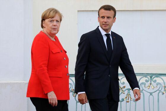 Merkel, Macron Reach Deal to Strengthen Euro Area Against Shocks