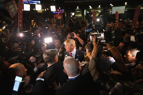 Republican presidential candidate Donald Trump (center) talks to reporters in the so-called Spin Alley after the first prime-time presidential debate in Cleveland.