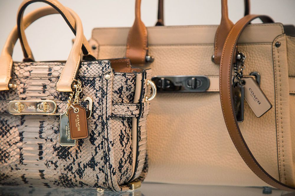 9f80bc8faf76 Handbags are displayed in the window of a Coach Inc. store in New York