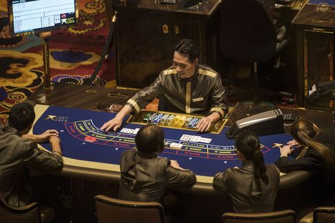 Employees sit at a gaming table.