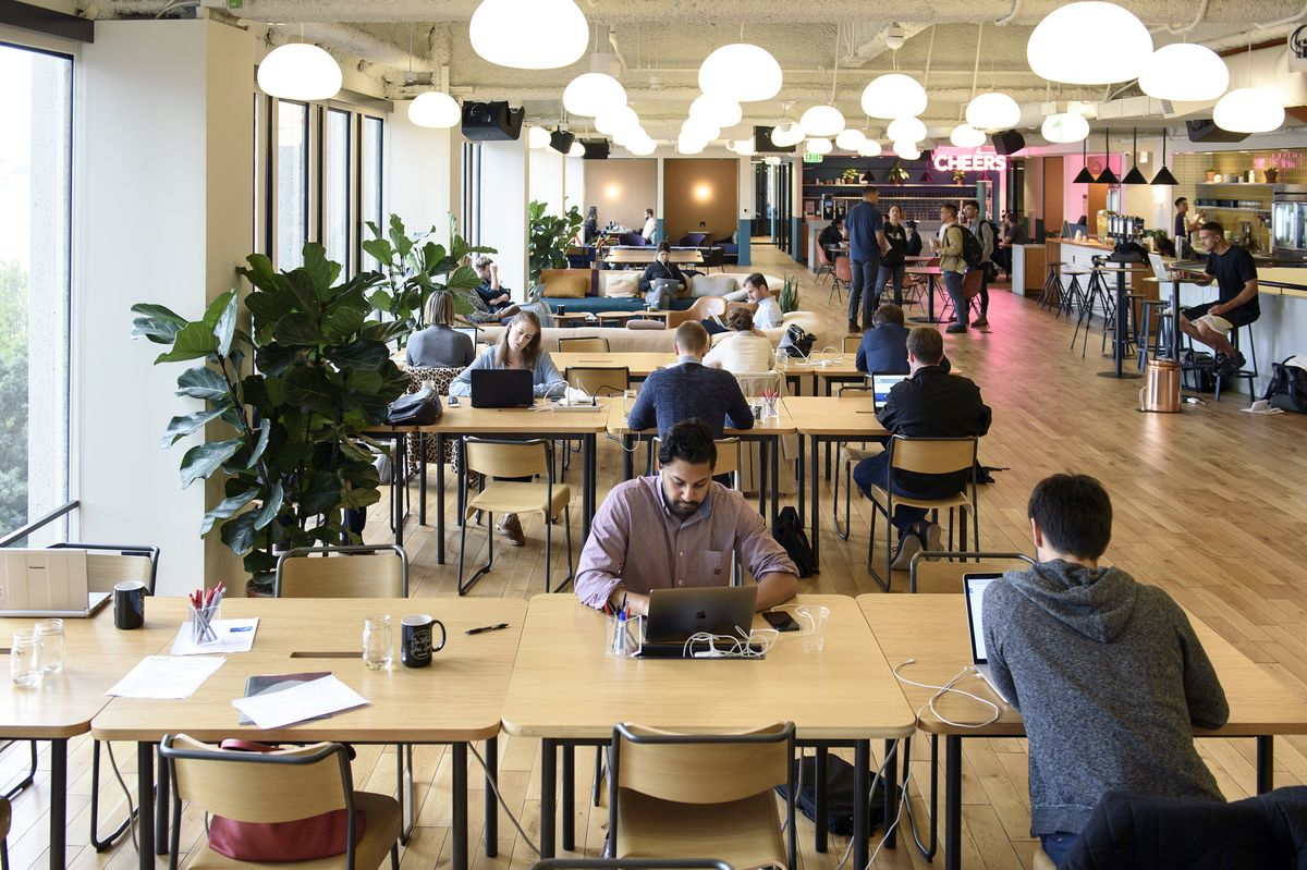 Wework buys meetup to bring people together outside of for Design office space online