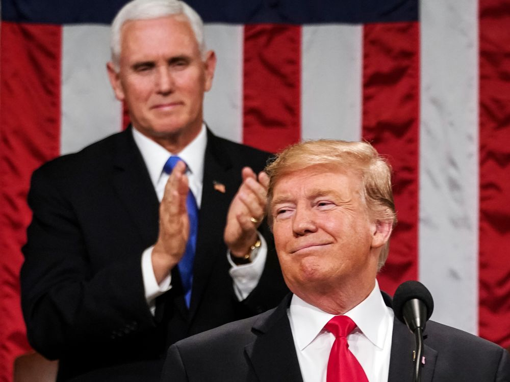 Mike Pence applauds Donald Trump during his State of the Union address in Feb. 2019.