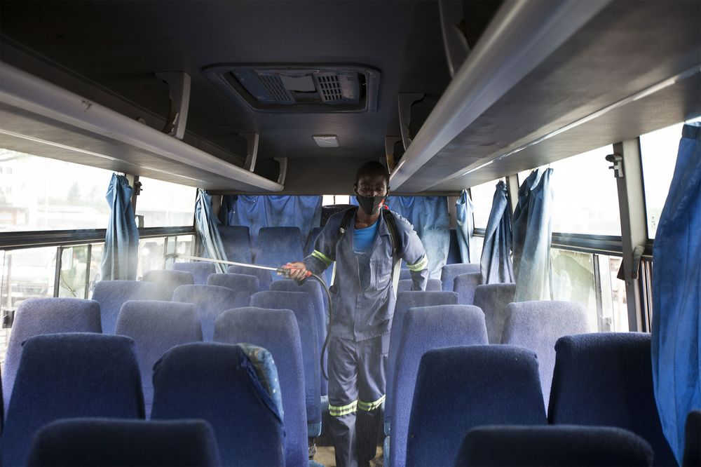 A worker disinfects a bus in Harare, Zimbabwe on Dec. 31, 2020.