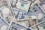 Japanese yen and U.S. dollar banknotes.