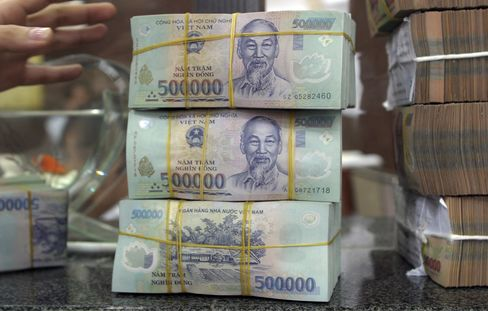 Vietnam Devalues Dong for First Time Since '11 to Boost Reserves