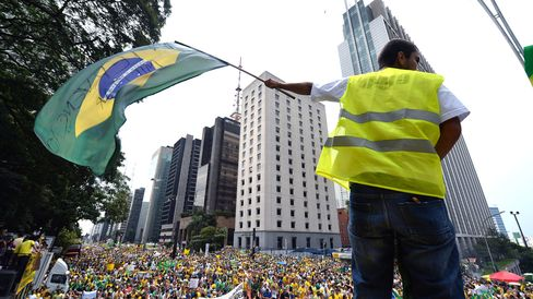 Demonstrators rally to protest against the government of president Dilma Rousseff in Paulista Avenue in Sao Paulo.