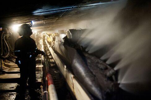 Coal Miners Shine Their Head Lamps As A Shearer Scrapes Coal