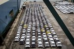 Newly manufactured imported automobiles sit on the dockside in the Auto Terminal SA parking lot at the port of Barcelona.