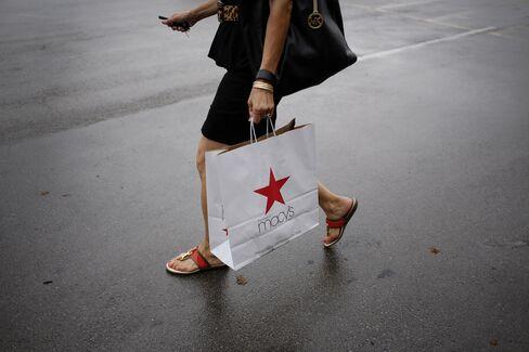 A Shopper Carries A Macy's Bag