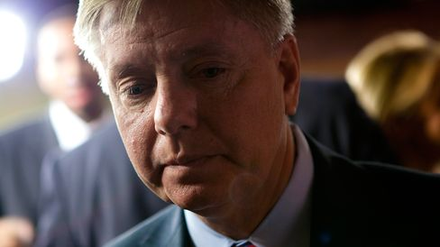 Senator Lindsey Graham, a Republican from South Carolina, departs from a news conference with other Republican Senators in Washington, D.C., U.S., on Wednesday, April 13, 2011.