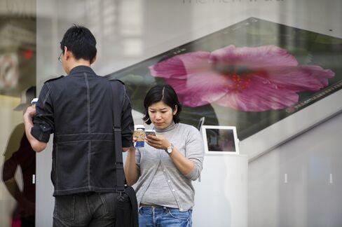 U.S. 'Snapback' Helps Apple to 3M Beat Earnings Estimates