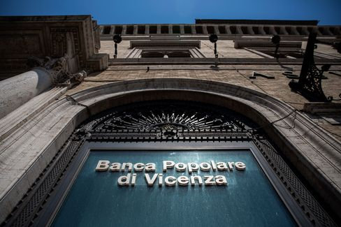 A logo is displayed on the window of a Banca Popolare di Vicenza SpA bank branch in Rome, Italy, on Monday, June 26, 2017. Italy orchestrated its biggest bank rescue on record, committing as much as 17 billion euros ($19 billion) to clean up two failed banks in one of its wealthiest regions, a deal that raises questions about the consistency of Europe's bank regulations. Photographer: Alessia Pierdomenico/Bloomberg