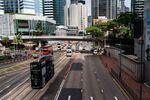 Vehicles travel along Queensway in Hong Kong, China.