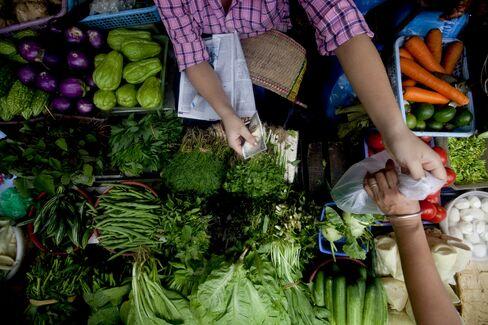 A vendor sells produce