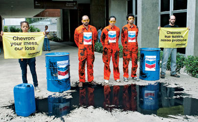 Greenpeace activists protest outside Chevron's Rio offices