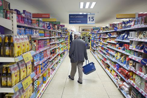 A Customer Carries Browses Food in a Tesco Metro Store in London