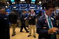 Traders work on the floor of the New York Stock Exchange (NYSE) in New York, U.S., on Friday, Oct. 7, 2016. U.S. stocks fell after jobs data showing steady growth in the labor market likely kept the Federal Reserve on track to tighten monetary policy this year as investors turn to the third-quarter earnings season. Photographer: Michael Nagle/Bloomberg