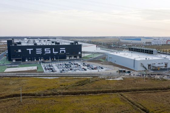 Tesla Set to Deliver First China-Built Car in Milestone for Musk