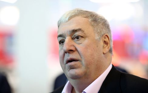 Mikhail Gutseriev, chairman of RussNeft OAO, speaks to an attendee between sessions at the St. Petersburg International Economic Forum (SPIEF) in Saint Petersburg, Russia, on June 19, 2015.