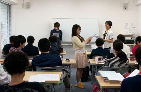 University student volunteers teach a free cram class in Tokyo.