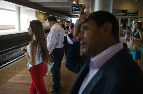 Commuters wait on a platform to board a New Jersey Transit train at the Frank R. Lautenberg Rail Station at Secaucus Junction in Secaucus, New Jersey, on Aug. 20, 2015.