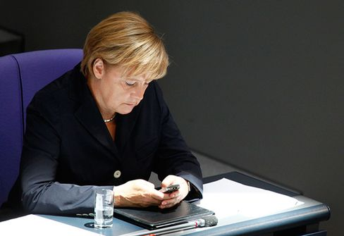 Merkel's cabinet of ministers backed a bill to remove legal quirks that hold providers of Wi-Fi hotspots liable users actions.