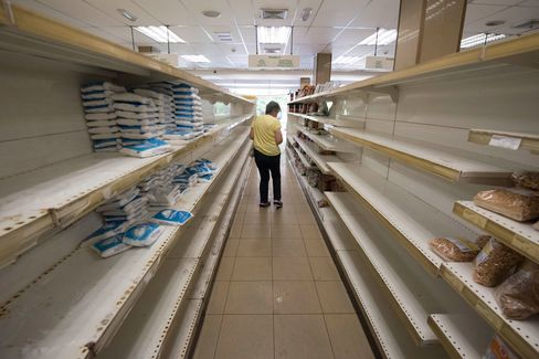 A person shops for groceries at a supermarket in Caracas on July 25.