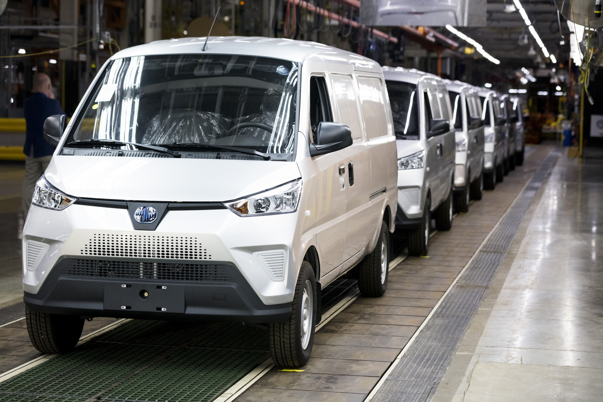 Electric Last Mile Solutions Inc. delivery vans on the production floor of the company's plant in Mishawaka, Indiana.