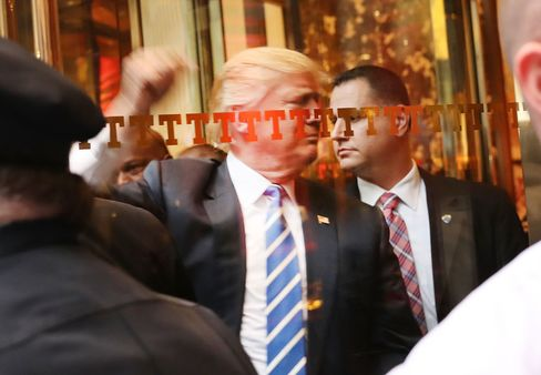 Donald Trump greets supporters outside Trump Towers in New York on Oct. 8.