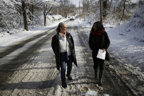 Campaign volunteers Catherine Johnson (left) and Amanda Bradley (right) canvass a neighborhood for Chris Christie in Hollis, New Hampshire, on Feb. 6, 2016.