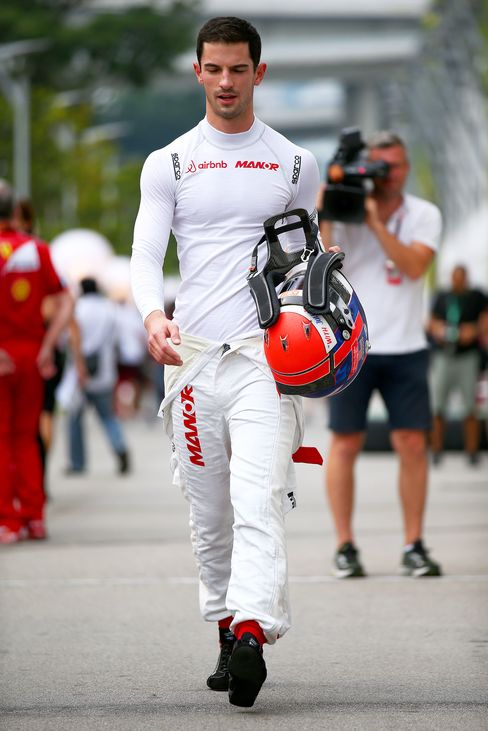 Rossiwalks in the paddock during previews to the Formula One Grand Prix of Singapore at Marina Bay Street Circuit.