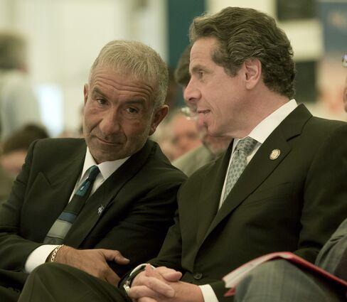 Alain Kaloyeros, left, and Andrew Cuomo