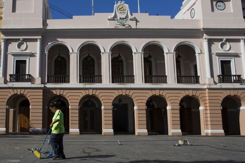 A Worker Sweeps up Litter in San Juan